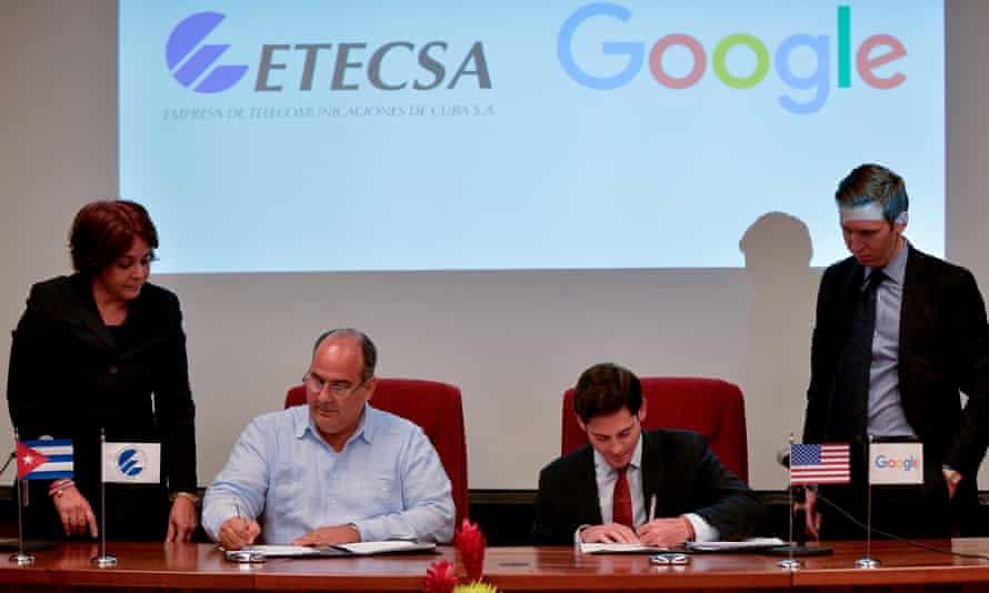The vice-president of Cuba's state-run telecommunications company ETECSA and the head of Google Cuba sign a memorandum of understanding in Havana Thursday.