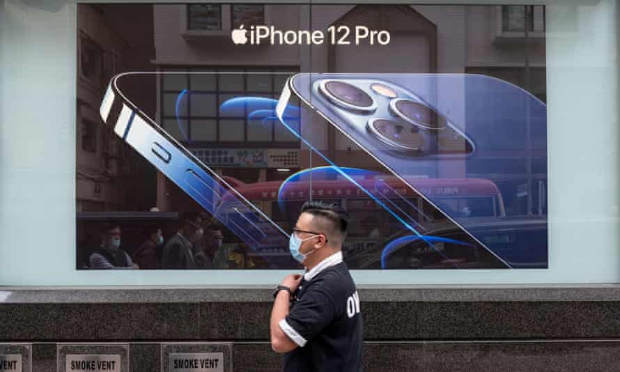 Man walks past add for the iPhone 12 in Hong Kong