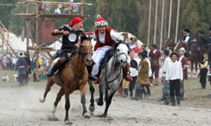 Artists perform during the second World Nomad Games at Issyk Kul lake in Cholpon-Ata, Kyrgyzstan.