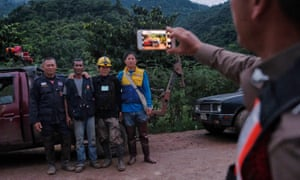 Rescue workers along the main road leading to the cave.