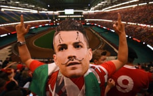 A Welsh fan regrets his choice of mask after Cristiano Ronaldo opens the scoring