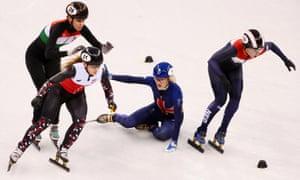 Elise Christie tumbles during the 1,000m heats