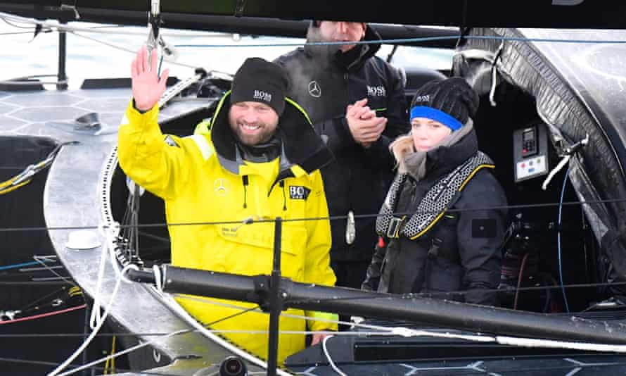 Alex Thomson celebrates with his wife Kate aboard his Imoca monohull Hugo Boss after crossing the finish line of the Vendee Globea round-the-world yacht race, off Les Sables d'Olonne, western France