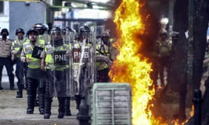 Demonstrators clash with police as protests continue in Caracas, Venezuela, on 20 April.