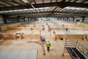 Llanelli, Wales Contractors work on temporary hospital wards inside the training ground at Parc y Scarlets Stadium, which is being prepared to provide additional bed space on its indoor training pitch for hundreds of people during the coronavirus pandemic