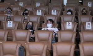 Customers at a cinema in Bangkok, Thailand