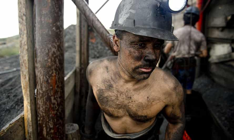 A Mexican miner emerges from a shaft in a coal mine in Agujita, Coahuila state, on 13 November 2012.