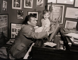 young Jamie Bernstein helps her father with his work in the 1950s.