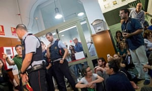 Catalan regional police (Mossos d'Esquadra) arrive to the IES Tarradell school to notify its principal that the school must be closed, in Barcelona, northeastern Spain, 29 September 2017.