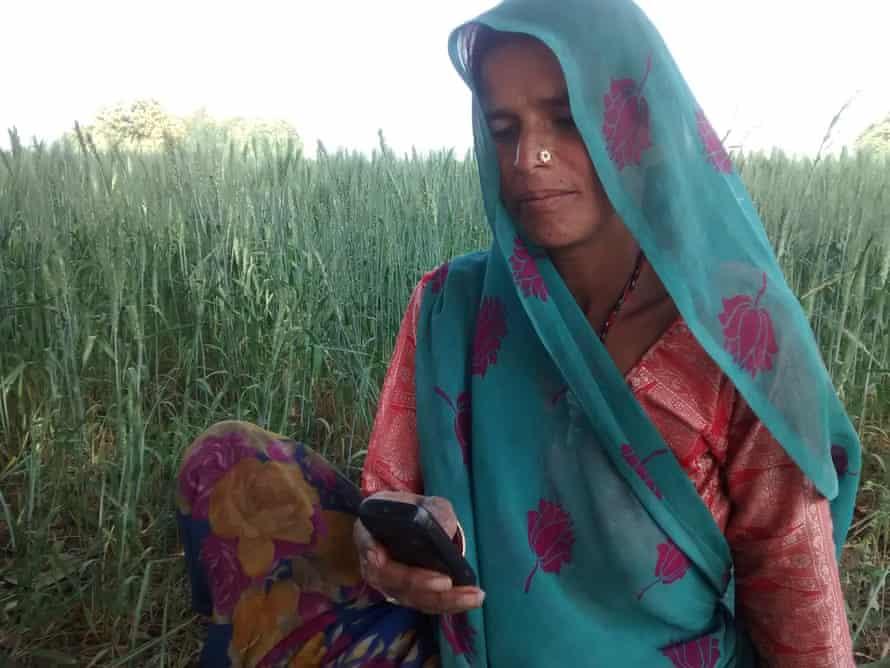 A woman prepares to record interviews for Khabar Lahariya in Lalitpur, Uttar Pradesh