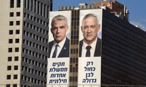 Yair Lapid and Benny Gantz, leaders of the Blue and White party, on election billboards in Tel Aviv. Opinion polls had Likud and the Blue and White neck and neck last week.