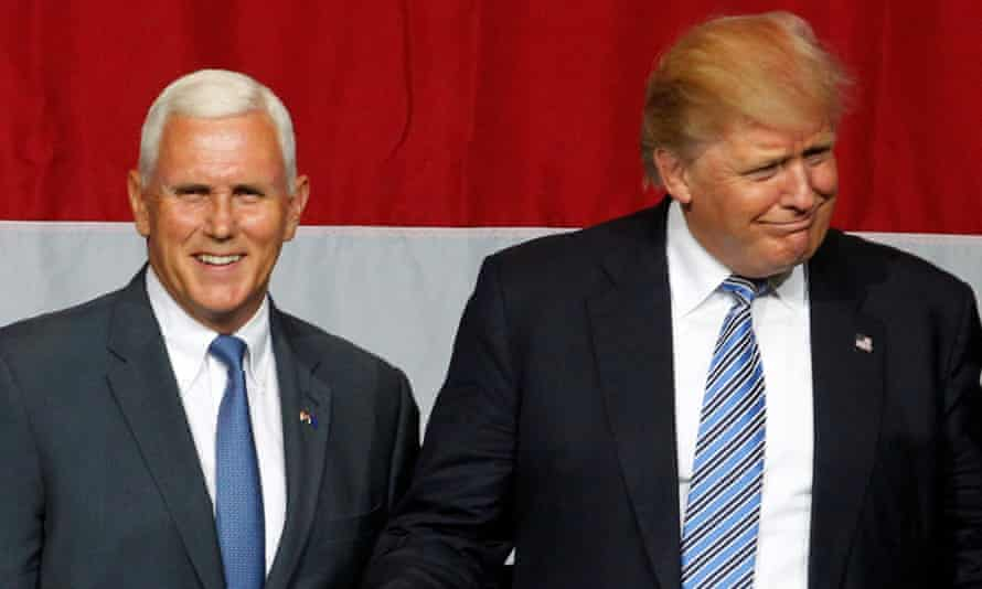 Donald Trump and Mike Pence wave to the crowd during a campaign stop in Westfield, Indiana.