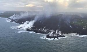 Lava from the Kilauea volcano enters the Pacific Ocean near Pahoa, Hawaii.