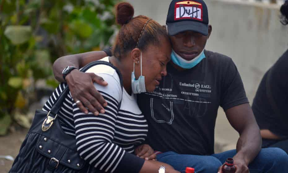 Relatives of one of 119 convicts killed in a flare-up of gang violence at a prison wait to recover the remains of their beloved one, outside the morgue in Guayaquil at the weekend.
