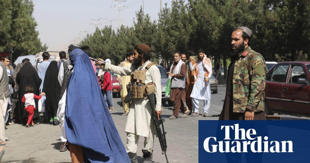 Afghans crowd airport gates as evacuation efforts wind down