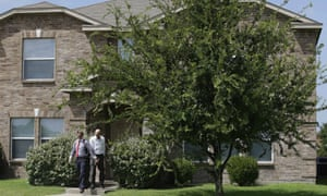 Investigators leave the home of Micah Xavier Johnson in the Dallas suburb of Mesquite, Texas, on Friday.