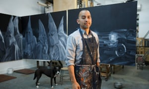 Vincent Valdez works on a four-panel painting of modern day klansmen in his studio in San Antonio.