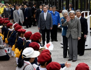 Emperor Akihito and Empress Michiko wave to kindergarten students while visiting the Kodomonokuni, or Children's Land, to mark the 60th anniversary of their marriage, in Yokohama in April 2019