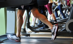 Running on the treadmill at a busy gym