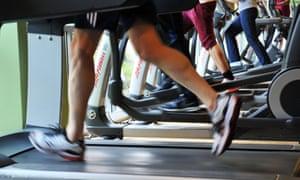 gym goers on the treadmills