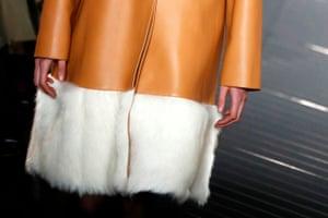 Furry hems on tan leather.