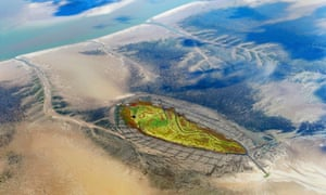 Sea level … aerial view of Norderoog, one of the 10 Halligen Islands off the coast of Germany.