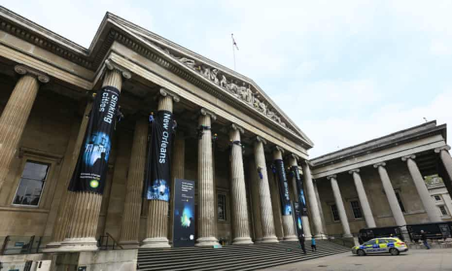Greenpeace climbers unfurl eight huge banners down the front columns of the British Museum