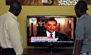 Kenyans watch Barack Obama on television in Nairobi, 2011.