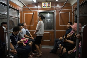 Pictures of Kim Il-sung and Kim Jong-il on metro