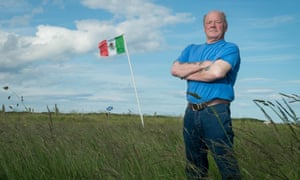 Michael Forbes beside the Mexican flag