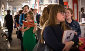 Scout's return ... a woman reads Go Set A Watchman by Harper Lee while queuing to buy it shortly after its midnight launch in London in July.