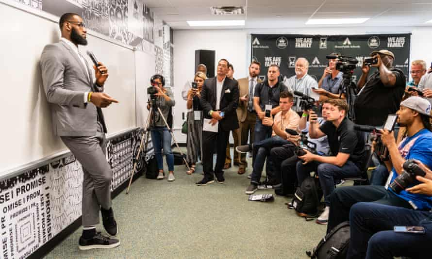LeBron James addresses the media after the opening ceremonies of the I Promise School.