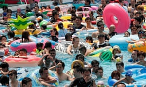 Bathers in a pool at Toshimaen amusement park in Tokyo