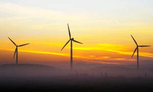 Early morning mist rises at the site of a wind farm in Burscough, Lancashire.
