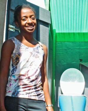 A customer of the first LooWatt model in Antananarivo', Madagascar.