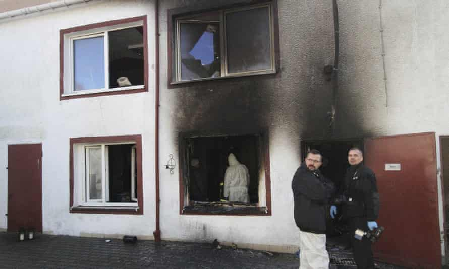 Police examine the site of the escape room in Koszalin where the five girls died in a fire.