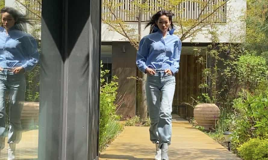 The South Korean model, Hyun Ji Shin, finds outdoor space for her CR Runway appearance, choosing casual trousers and top from her own wardrobe.