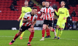 Billy Sharp celebrates after tucking away his penalty to give Sheffield United the lead.