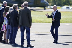 Joe Biden is greeted by New Jersey Governor Phil Murphy and others as he arrives for briefing about the impact of Hurricane Ida.