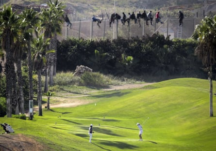 Golf course by the border fence in Malilla