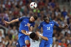 Emre Can is outjumped by Giroud and Matuidi.