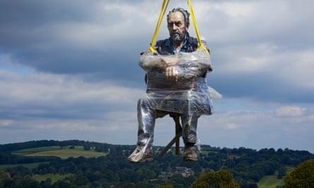 Seated Figure being lifted into its new home at Yorkshire Sculpture Park on Wednesday