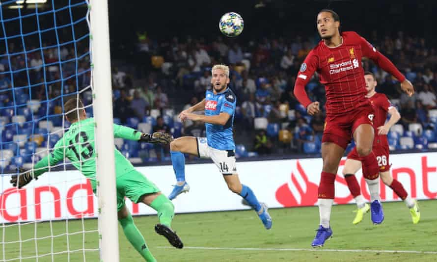 Virgil van Dijk (right) believes Liverpool can carry on their winning ways in the Premier League despite defeat in Naples.