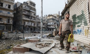 A rebel fighter in the Syrian city of Aleppo after heavy fighting.