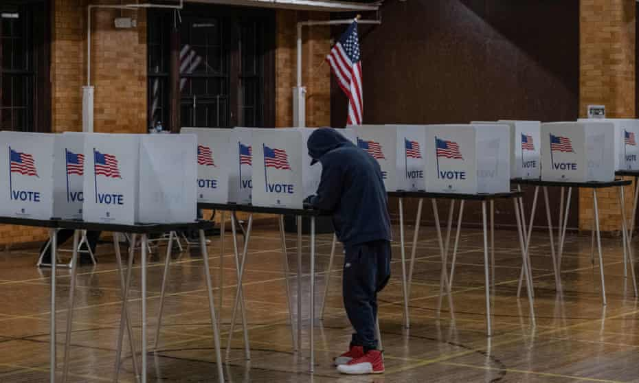 A resident casts his vote on 3 November 2020 in Flint, Michigan.