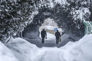 Van, Turkey. People walk after heavy snowfall in the eastern Turkish province. Roads have closed in 687 settlements in Van because of more than a metre of snow