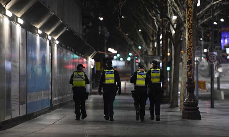 police patrol empty streets in melbourne