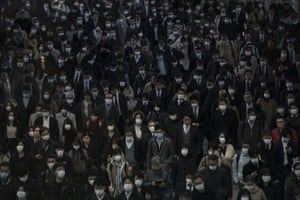 Tokyo, Japan Commuters wear masks on their way to work. Tokyo Governor Yuriko Koike has requested citizens refrain from going outside this weekend for nonessential reasons after 41 cases of new coronavirus infections were confirmed yesterday