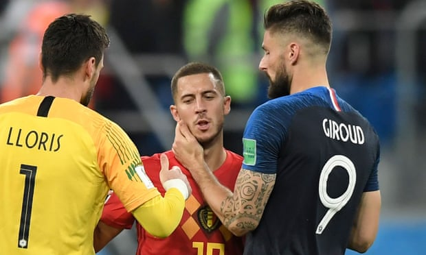 Eden Hazard is consoled by France's Hugo Lloris and Olivier Giroud after the semi-final.