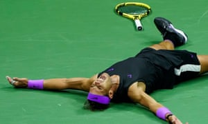 Rafael Nadal collapses on the floor after securing the winning point in New York.
